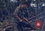 Image of Wrecked US Army UH-1H helicopter A Shau Valley Vietnam, 1968, second 57 stock footage video 65675026858