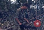 Image of Wrecked US Army UH-1H helicopter A Shau Valley Vietnam, 1968, second 58 stock footage video 65675026858