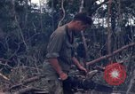 Image of Wrecked US Army UH-1H helicopter A Shau Valley Vietnam, 1968, second 59 stock footage video 65675026858