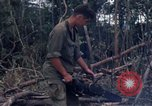 Image of Wrecked US Army UH-1H helicopter A Shau Valley Vietnam, 1968, second 60 stock footage video 65675026858