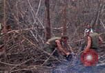 Image of Wrecked US Army UH-1H helicopter A Shau Valley Vietnam, 1968, second 61 stock footage video 65675026858