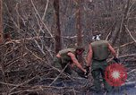 Image of Wrecked US Army UH-1H helicopter A Shau Valley Vietnam, 1968, second 62 stock footage video 65675026858