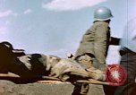 Image of Wounded US Marines on D-Day of Iwo Jima Iwo Jima, 1945, second 22 stock footage video 65675029319