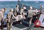 Image of Wounded US Marines on D-Day of Iwo Jima Iwo Jima, 1945, second 58 stock footage video 65675029319