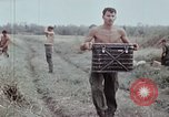 Image of unloading supplies Vietnam, 1968, second 43 stock footage video 65675030470