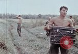 Image of unloading supplies Vietnam, 1968, second 44 stock footage video 65675030470