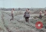 Image of unloading supplies Vietnam, 1968, second 46 stock footage video 65675030470