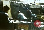 Image of Koreans loading wheat at dock South Korea, 1968, second 2 stock footage video 65675030472