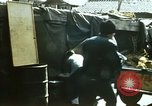 Image of Koreans loading wheat at dock South Korea, 1968, second 3 stock footage video 65675030472