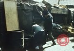 Image of Koreans loading wheat at dock South Korea, 1968, second 6 stock footage video 65675030472