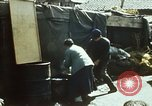 Image of Koreans loading wheat at dock South Korea, 1968, second 7 stock footage video 65675030472