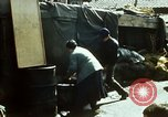 Image of Koreans loading wheat at dock South Korea, 1968, second 9 stock footage video 65675030472