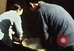 Image of Koreans loading wheat at dock South Korea, 1968, second 23 stock footage video 65675030472