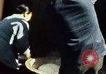 Image of Koreans loading wheat at dock South Korea, 1968, second 25 stock footage video 65675030472
