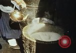 Image of Koreans loading wheat at dock South Korea, 1968, second 31 stock footage video 65675030472