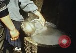 Image of Koreans loading wheat at dock South Korea, 1968, second 33 stock footage video 65675030472