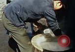 Image of Koreans loading wheat at dock South Korea, 1968, second 44 stock footage video 65675030472