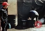 Image of Koreans loading wheat at dock South Korea, 1968, second 59 stock footage video 65675030472