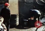 Image of Koreans loading wheat at dock South Korea, 1968, second 61 stock footage video 65675030472
