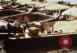 Image of Koreans loading wheat at dock South Korea, 1968, second 62 stock footage video 65675030472