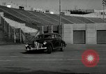 Image of high speed turns by car in front of stadium Akron Ohio USA, 1941, second 5 stock footage video 65675030482