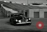 Image of high speed turns by car in front of stadium Akron Ohio USA, 1941, second 6 stock footage video 65675030482