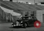 Image of high speed turns by car in front of stadium Akron Ohio USA, 1941, second 23 stock footage video 65675030482