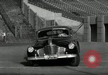 Image of high speed turns by car in front of stadium Akron Ohio USA, 1941, second 24 stock footage video 65675030482