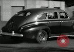 Image of high speed turns by car in front of stadium Akron Ohio USA, 1941, second 27 stock footage video 65675030482