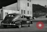 Image of high speed turns by car in front of stadium Akron Ohio USA, 1941, second 28 stock footage video 65675030482