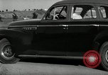 Image of high speed turns by car in front of stadium Akron Ohio USA, 1941, second 32 stock footage video 65675030482