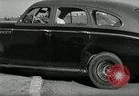Image of high speed turns by car in front of stadium Akron Ohio USA, 1941, second 33 stock footage video 65675030482