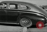 Image of high speed turns by car in front of stadium Akron Ohio USA, 1941, second 34 stock footage video 65675030482