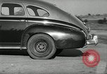 Image of high speed turns by car in front of stadium Akron Ohio USA, 1941, second 35 stock footage video 65675030482