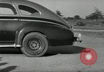 Image of high speed turns by car in front of stadium Akron Ohio USA, 1941, second 36 stock footage video 65675030482