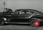 Image of high speed turns by car in front of stadium Akron Ohio USA, 1941, second 49 stock footage video 65675030482