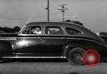 Image of high speed turns by car in front of stadium Akron Ohio USA, 1941, second 50 stock footage video 65675030482