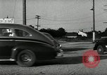 Image of high speed turns by car in front of stadium Akron Ohio USA, 1941, second 51 stock footage video 65675030482