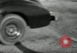 Image of high speed turns by car in front of stadium Akron Ohio USA, 1941, second 55 stock footage video 65675030482