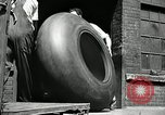 Image of workers rolling large tire tubes Akron Ohio USA, 1941, second 10 stock footage video 65675030483