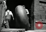 Image of workers rolling large tire tubes Akron Ohio USA, 1941, second 12 stock footage video 65675030483