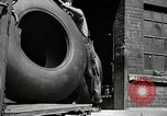Image of workers rolling large tire tubes Akron Ohio USA, 1941, second 13 stock footage video 65675030483