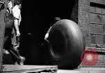 Image of workers rolling large tire tubes Akron Ohio USA, 1941, second 14 stock footage video 65675030483