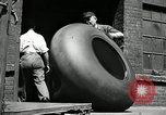 Image of workers rolling large tire tubes Akron Ohio USA, 1941, second 15 stock footage video 65675030483