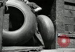 Image of workers rolling large tire tubes Akron Ohio USA, 1941, second 16 stock footage video 65675030483