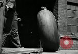 Image of workers rolling large tire tubes Akron Ohio USA, 1941, second 17 stock footage video 65675030483