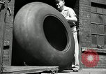 Image of workers rolling large tire tubes Akron Ohio USA, 1941, second 18 stock footage video 65675030483