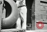 Image of workers rolling large tire tubes Akron Ohio USA, 1941, second 19 stock footage video 65675030483