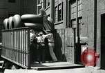Image of workers rolling large tire tubes Akron Ohio USA, 1941, second 20 stock footage video 65675030483