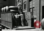 Image of workers rolling large tire tubes Akron Ohio USA, 1941, second 21 stock footage video 65675030483